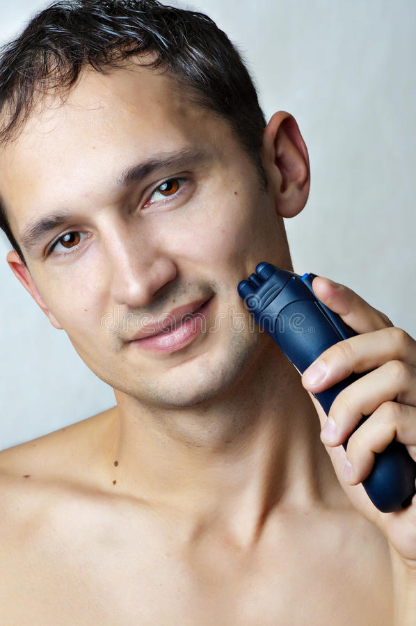 Download Man Shaved His Chin By Electric Shaver Stock Photos - Image: 23129483