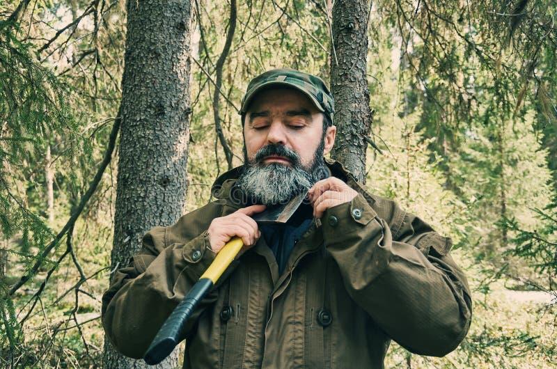 Man Shaves beard ax stock image