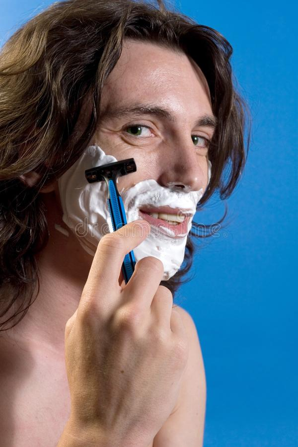 Man shaving royalty free stock image