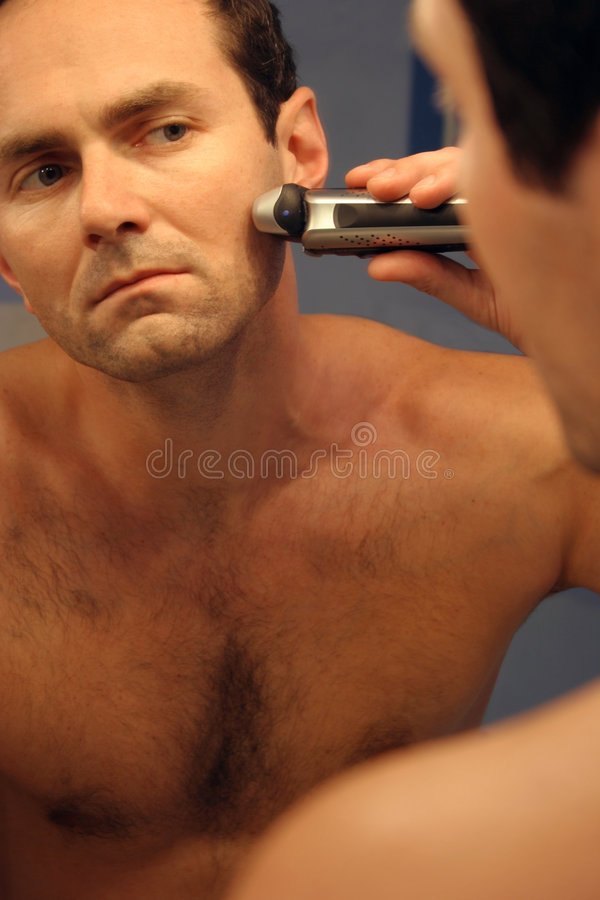Man shaving royalty free stock photos