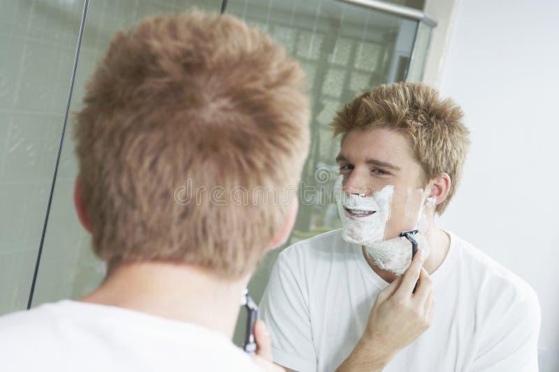 Man Shaving In Bath Room Royalty Free Stock Photography