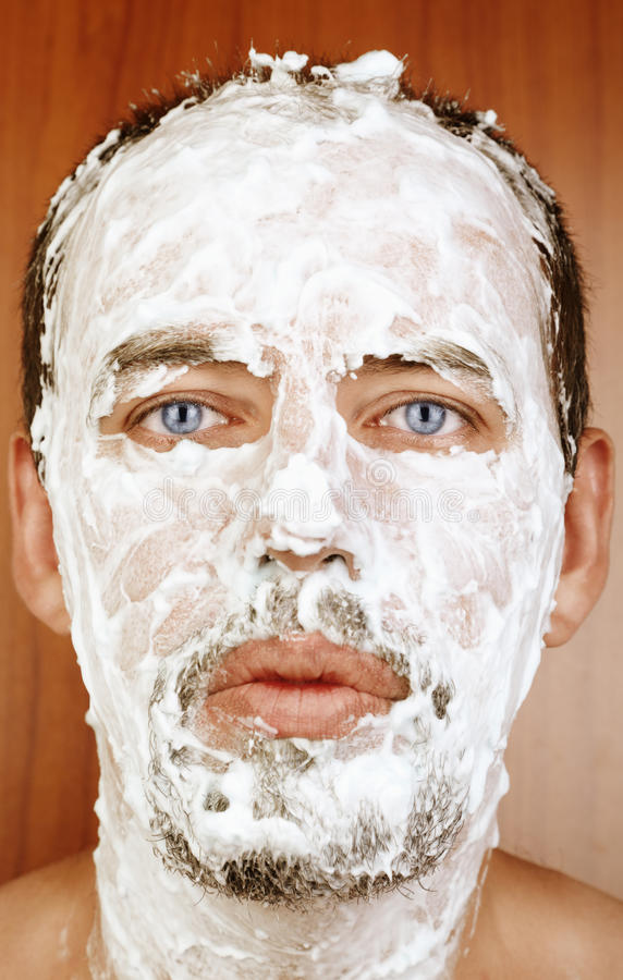 man with shaving cream on face stock image