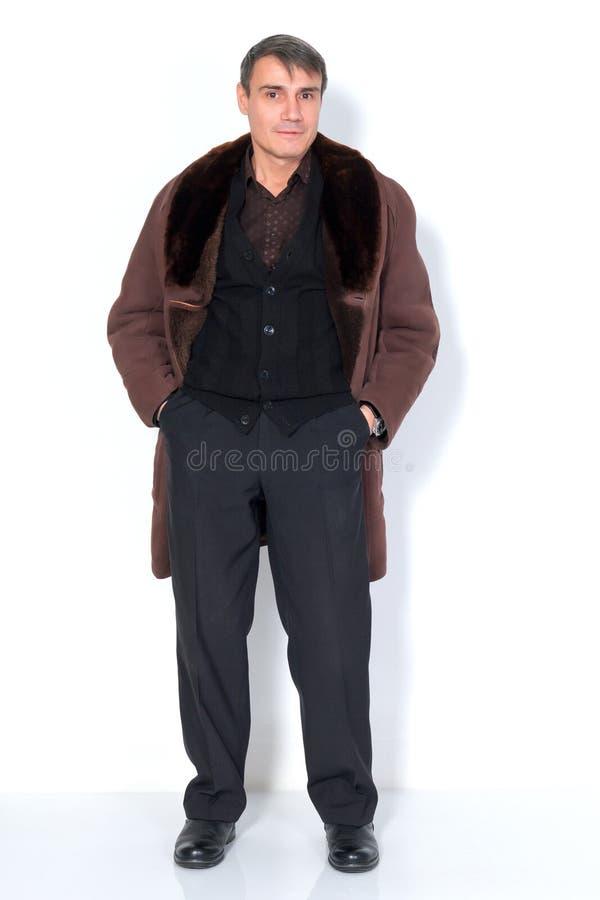 A man in a sheepskin coat. stock photo