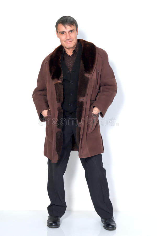 A man in a sheepskin coat. royalty free stock image