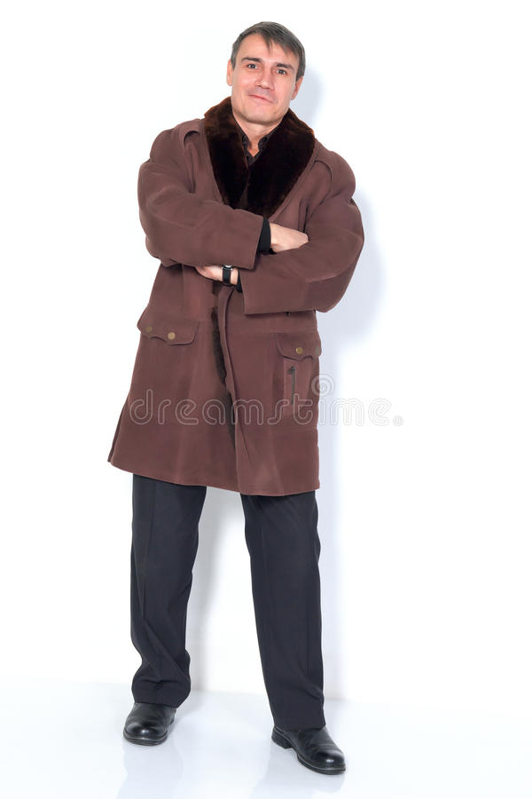 A man in a sheepskin coat. stock image