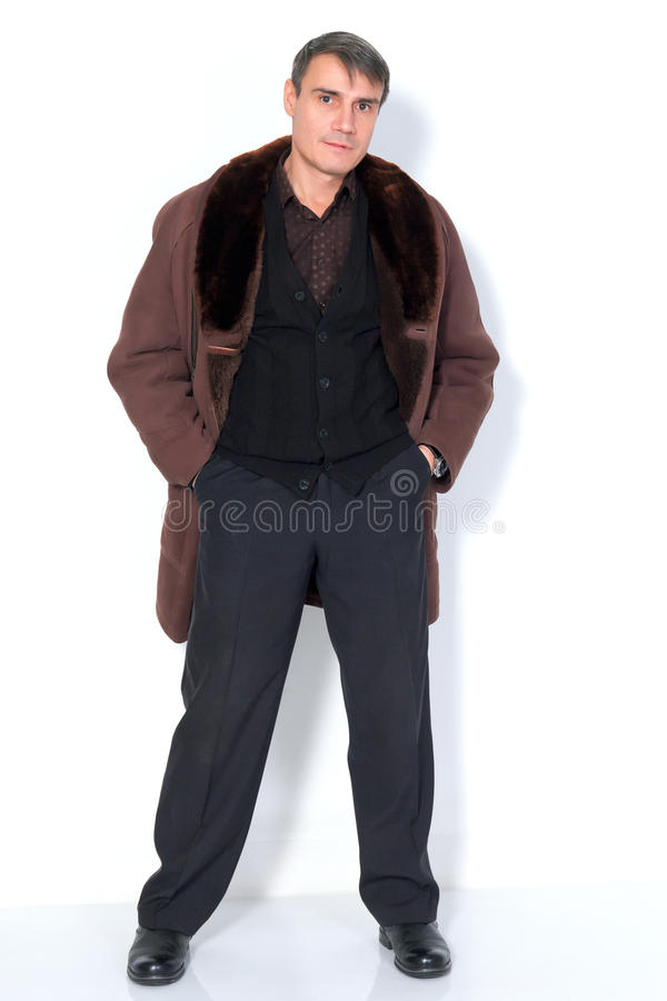 A man in a sheepskin coat. royalty free stock photography