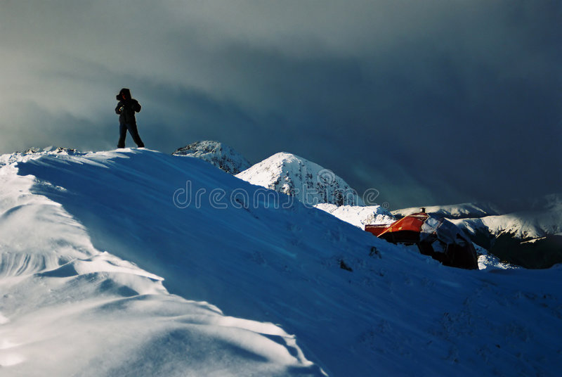 Man and shelter in Piatra Craiului stock image