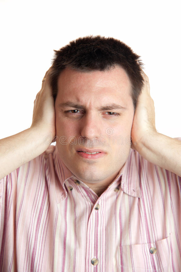 Man Shielding His Ears With Hands Royalty Free Stock Photos