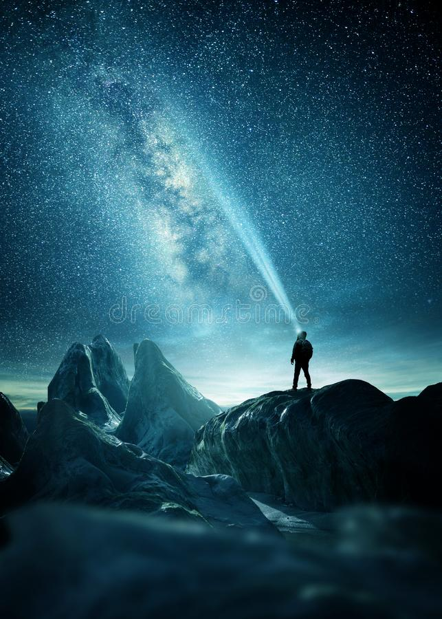 A Man Shining A Light Into The Night Sky stock photo
