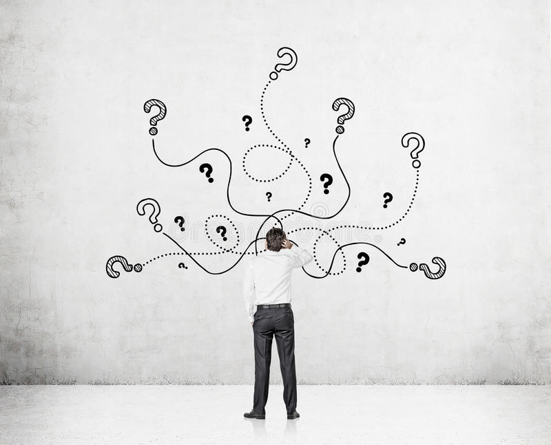 Man in shirt and question marks stock image