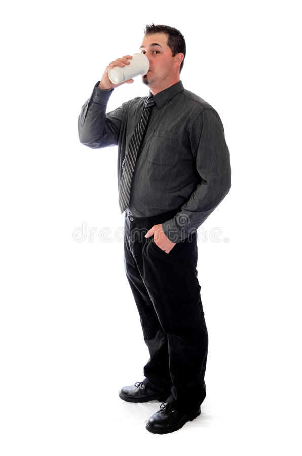 Man in shirt and tie drinking coffee. A man in shirt and tie drinking coffee, raised eyeborw royalty free stock image
