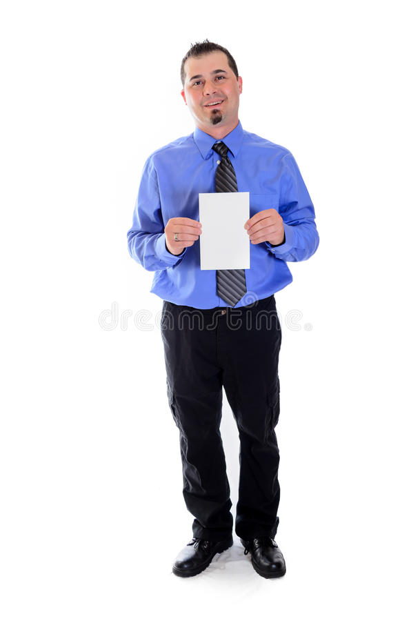 Man shirt and tie holding blank card smiling. A smiling business man in blue shirt and tie holding a blank card and smiling stock photo