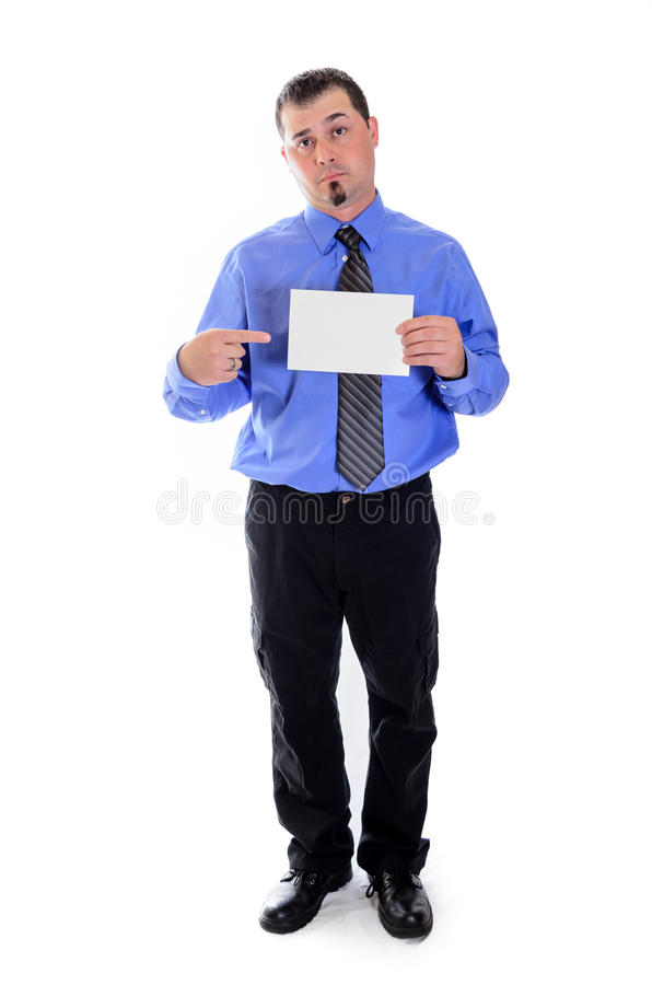Man in shirt and tie holding blank card. A smiling business man in striped shirt and tie pointing to a blank card royalty free stock photos