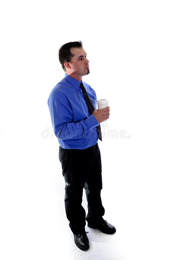 Man in shirt and tie holding a coffee cup. A man in shirt and tie holding a coffee cup, looking/facing to the right royalty free stock image