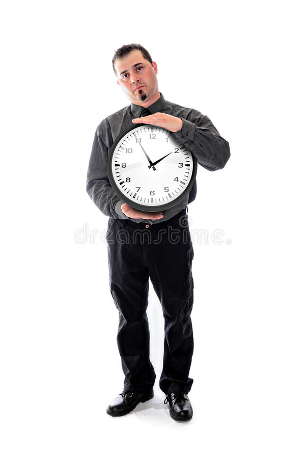 Man in shirt and tie holding large clock. Man in shirt and tie holding a large wall clock stock photography
