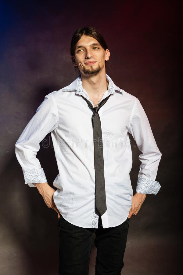 Man in shirt and tie. Masculinity fashion concept. Man in shirt and tie. Young long haired male on dark background royalty free stock images