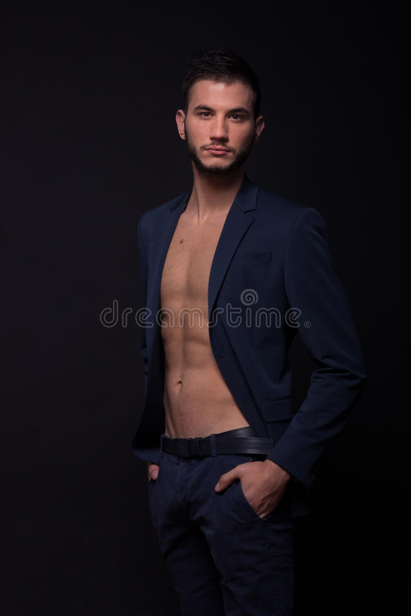 Man shirtless abs suit jacket looking royalty free stock photos