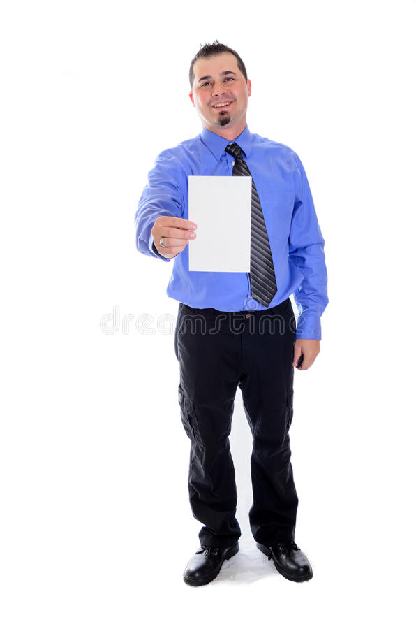 Man shirt and tie holding blank vertical card. A smiling business man in striped shirt and tie pointing to a blank vertical card stock photo