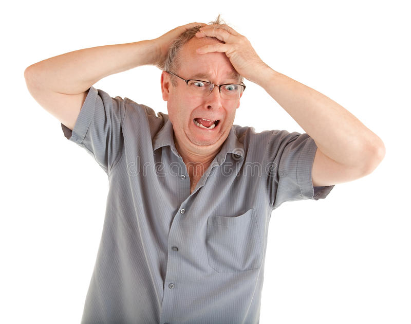 Man in Shock Just Got Very Bad News. Man holding his head in disbelief and shocked just got very bad news royalty free stock photo