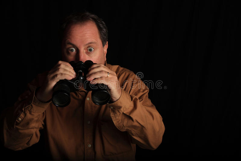 Download Man Shocked With A Large Pair Of Binoculars Stock Image - Image: 11066075