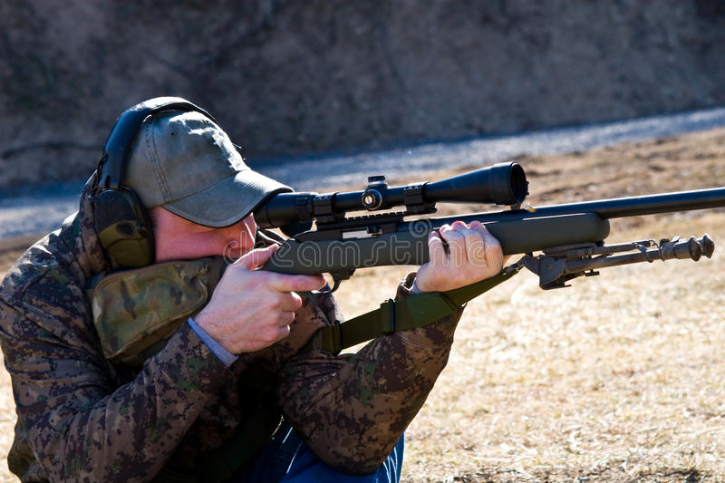 Download Man Shooting Rifle stock photo. Image of sport, precision - 13060062