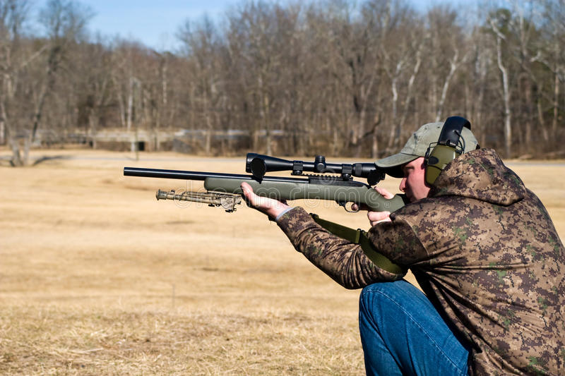 Download Man Shooting Rifle stock image. Image of sighting, sports - 13060071