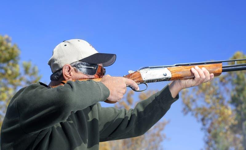 Man Shooting Shotgun stock photography