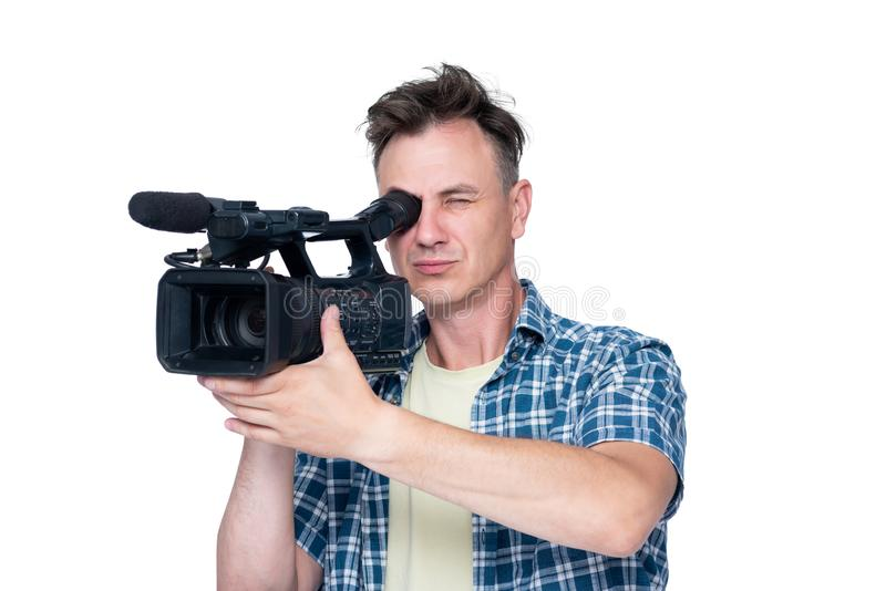 Man shoots a video with a professional camcorder, isolated on white background stock images