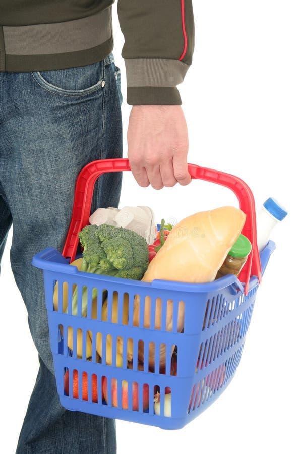 Man with shopping basket royalty free stock photos