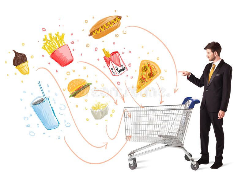 Man with shopping cart with toxic junk food. Businessman pushing a shopping cart and toxic junk food and cigarettes coming out of it stock images