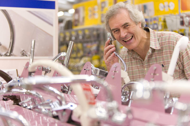 Man shopping in hardware store, portrait stock photos