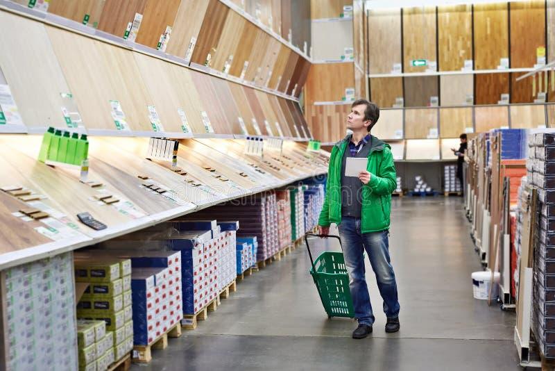 Man shopping laminate in DIY shop stock photos