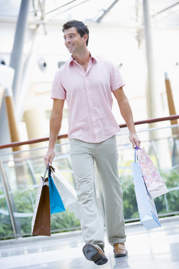 Man shopping in mall stock image