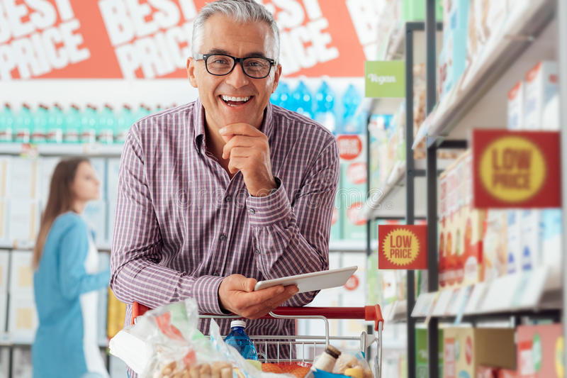 Download Man shopping at the store stock image. Image of online - 80942871