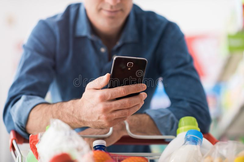 Man shopping and using mobile apps royalty free stock photos