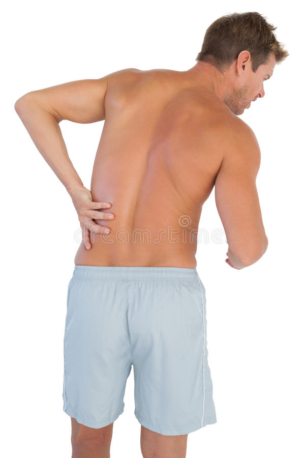 Download Man With Shorts Suffering From Lower Back Pain Royalty Free Stock Image - Image: 32510056