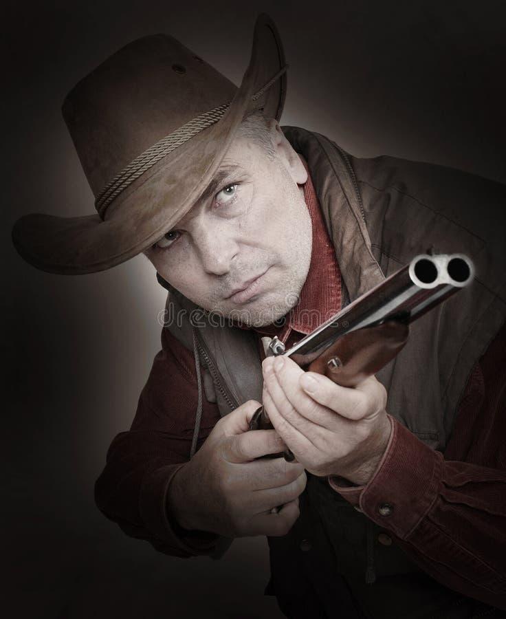 Man with shotgun. royalty free stock photography