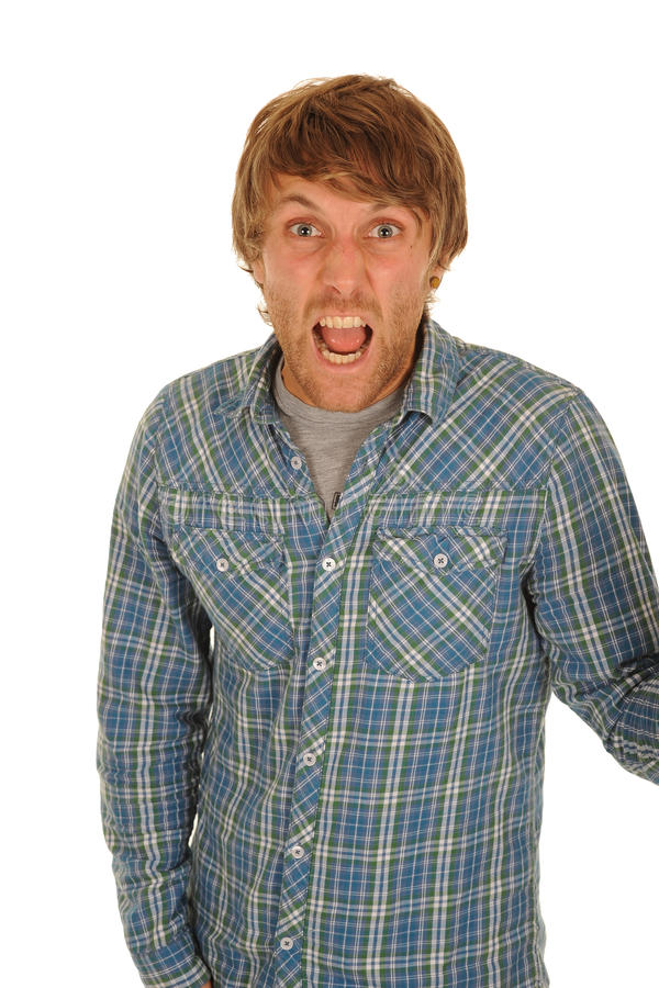 Man shouting. Young man in blue plaid shirt, shouting loudly stock photo