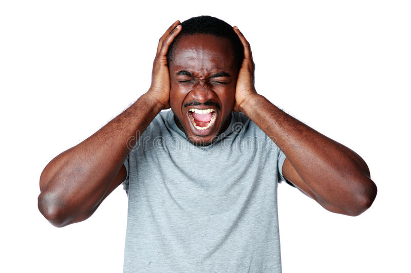 Man shouting and closing ear by his hands stock photography