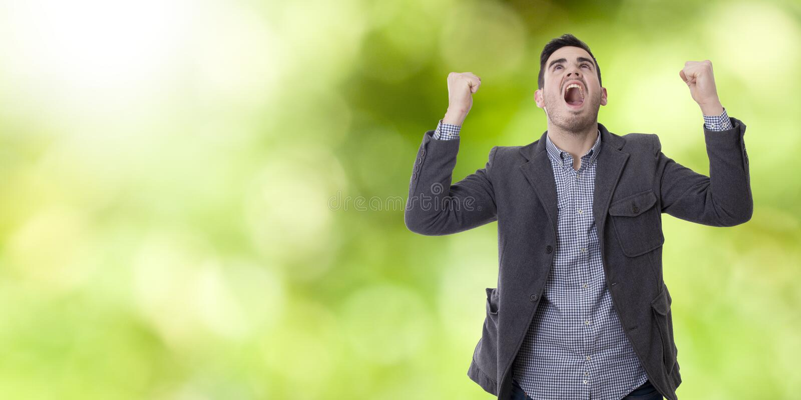 Man shouting enraged. Adult young man shouting enraged with the arms raised royalty free stock photo
