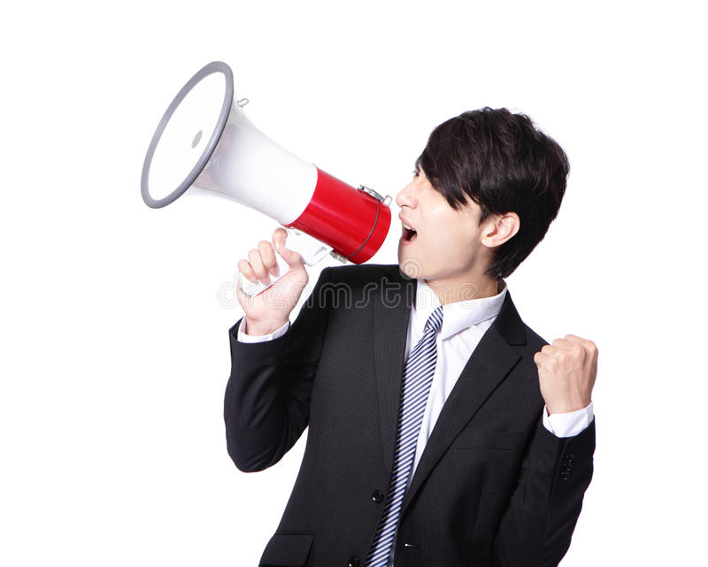 Man shouting into megaphone and show fist. Young business man happy shouting into a megaphone and show his fist isolated over a white background, asian model royalty free stock images