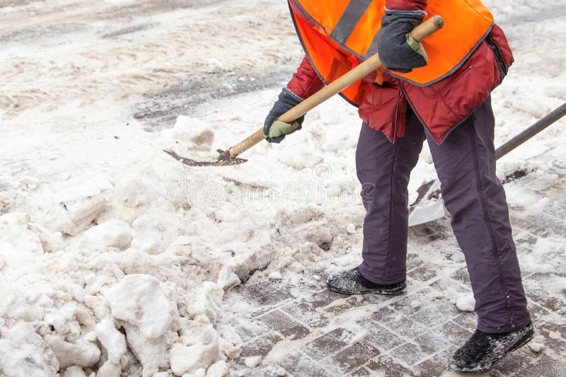 People shoveling snow. Snow clearance after a heavy snowfall royalty free stock photo