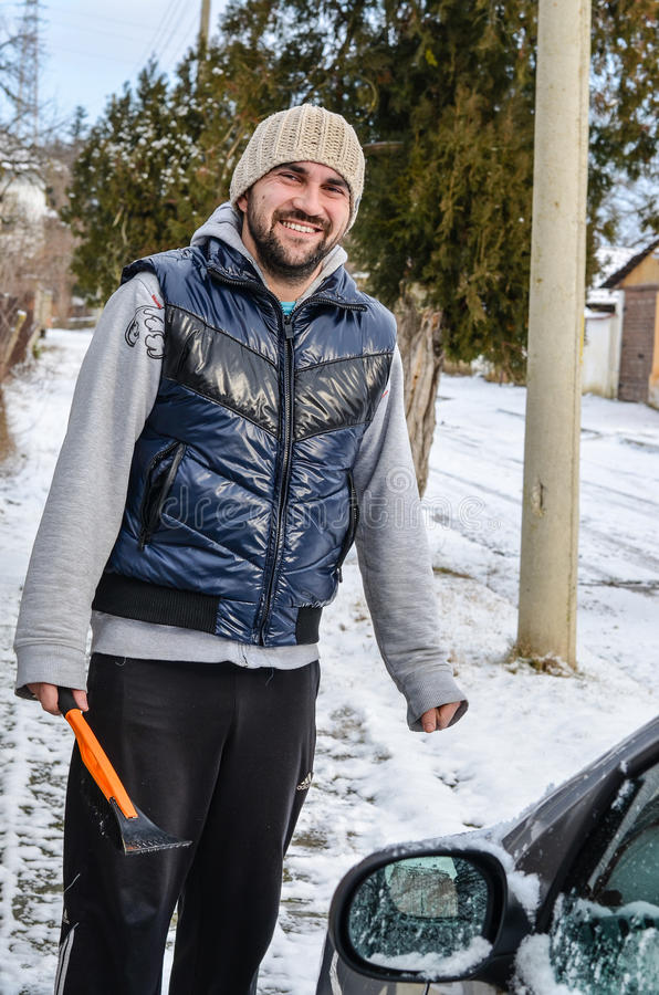 Man shovelling and removing snow royalty free stock image
