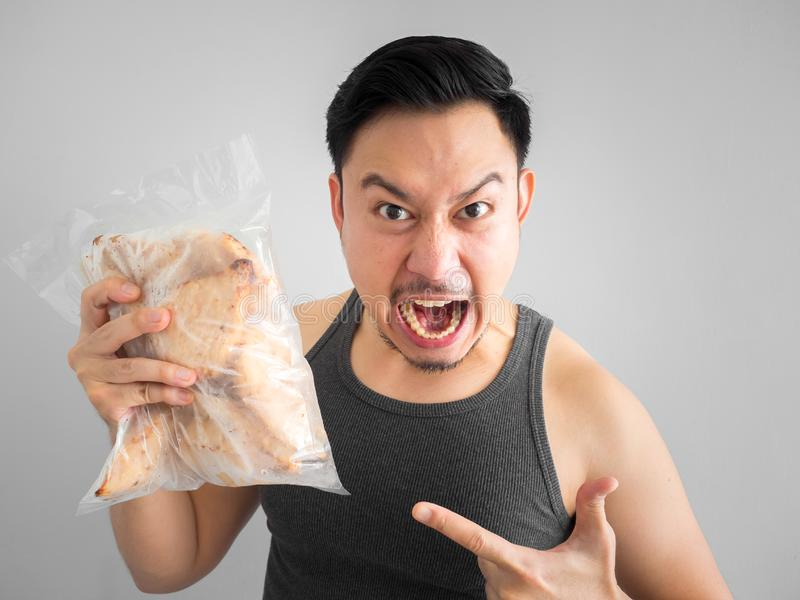 Man show chicken breast diet for healthy life. Asian man show chicken breast pure protien good start diet for healthy life royalty free stock photo