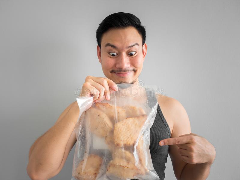 Man show chicken breast diet for healthy life. Asian man show chicken breast pure protien good start diet for healthy life stock images