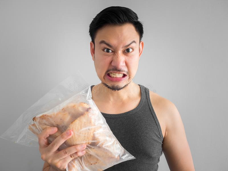 Man show chicken breast diet for healthy life. Asian man show chicken breast pure protien good start diet for healthy life stock photo