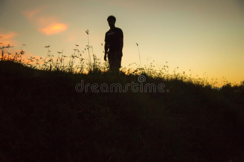 Man show hands silhouette sunset background.  stock photography