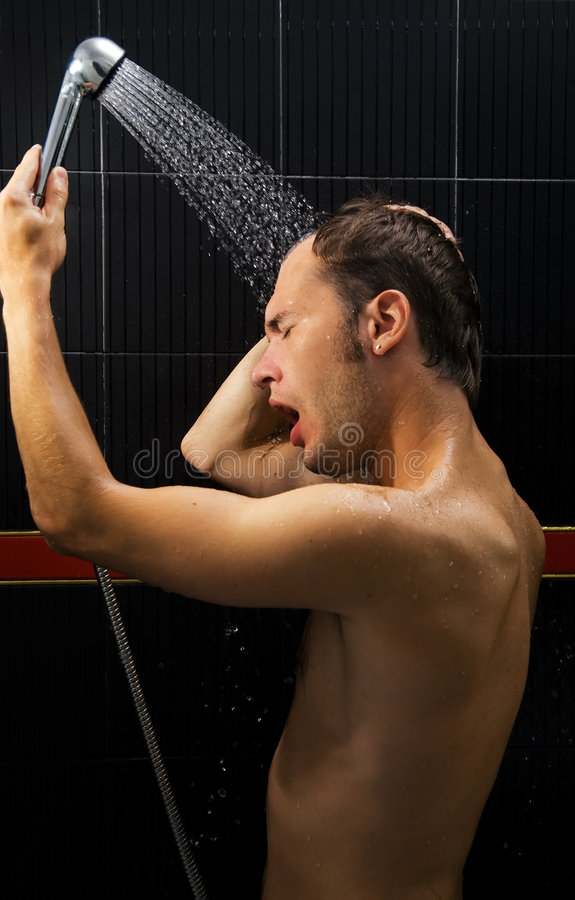 Man in a shower royalty free stock image