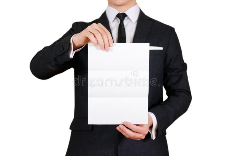 Man showing blank black flyer brochure booklet. Leaflet presentation. Pamphlet hold hands. Man show clear offset paper. Sheet. Template. Man in a black suit stock image