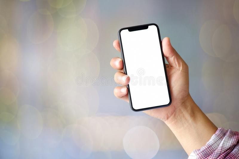 man showing blank screen mobile phone over blurred background. stock images
